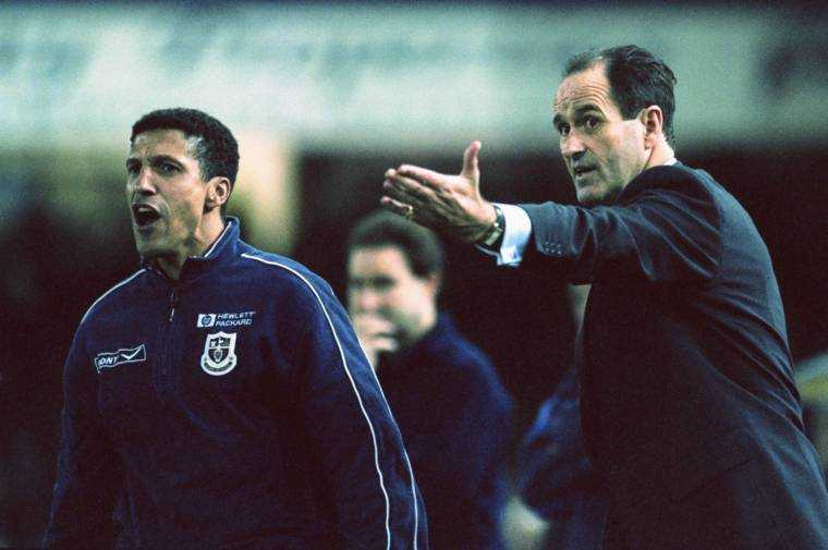 LEICESTER, UK - OCTOBER 19: Tottenham Hotspur manager George Graham makes a point as coach Chris Hughton (l) reacts during an FA Carling Premiership match between Leicester City and Spurs at Filbert Street on October 19, 1998 in Leicester, England.  (Photo by Ross Kinnaird / Allsport / Getty Images)
